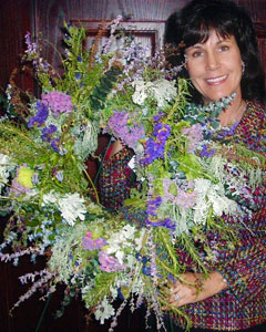 Carrie with fresh herb wreath